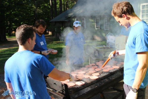 cooking burgers for lunch at an American summer camp