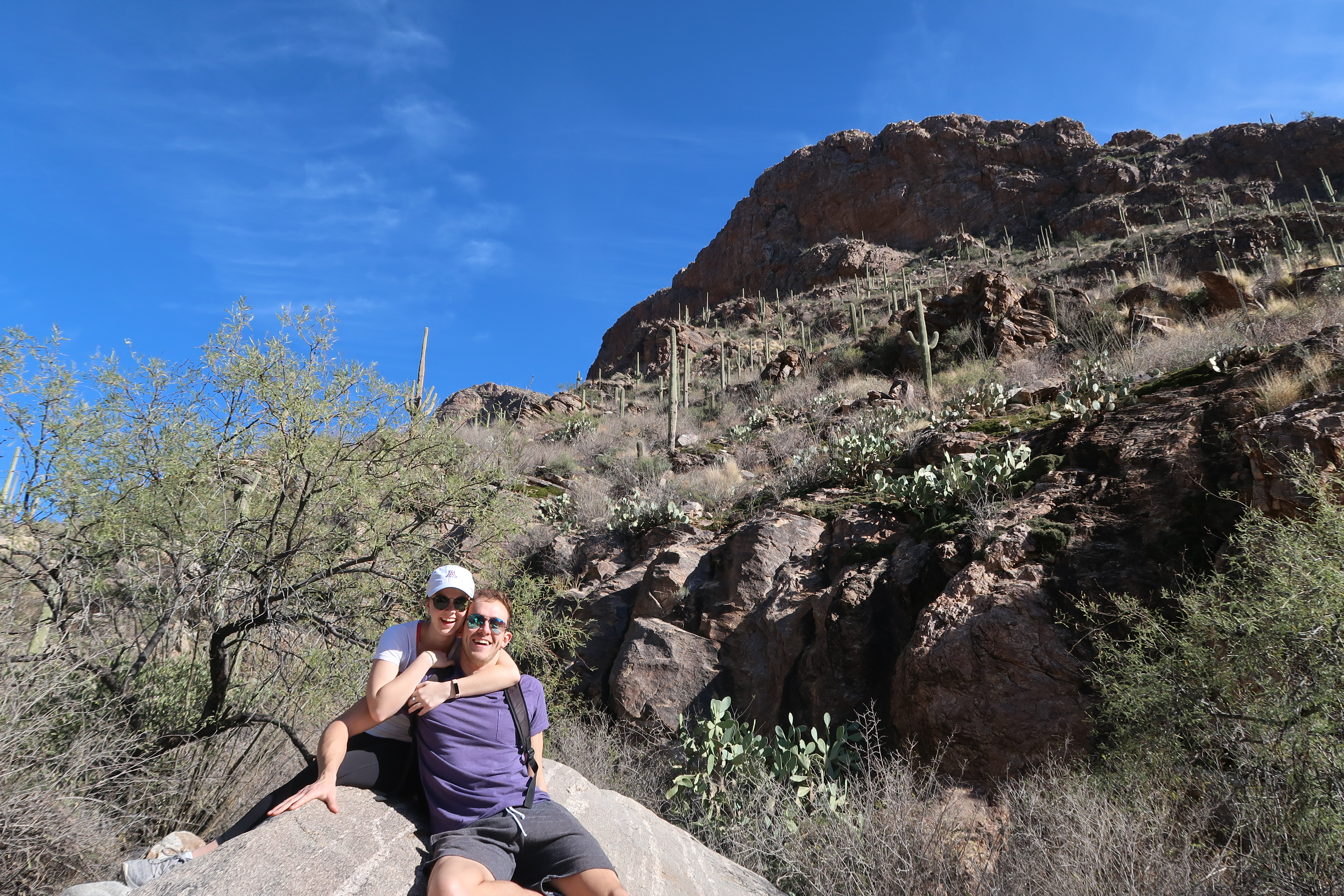 posing on a giant rock in pima canyon
