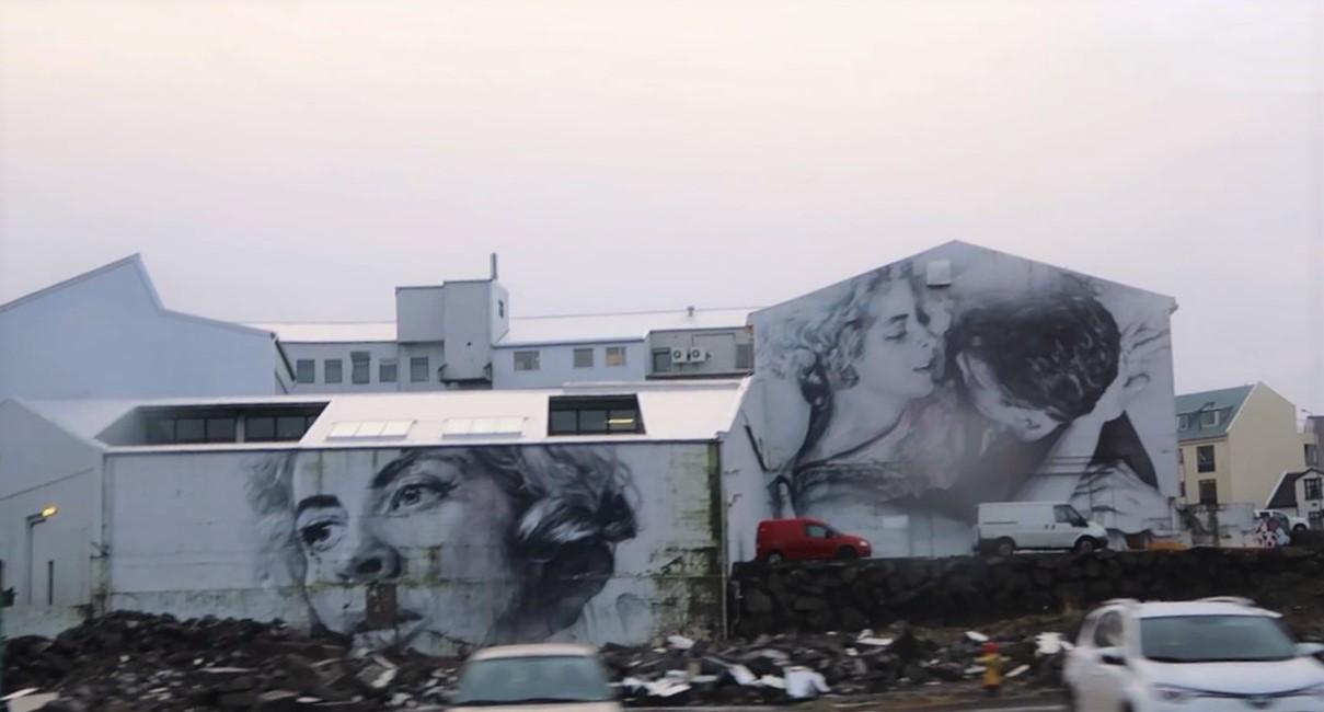 Stunning street art of a couple in reykjavik